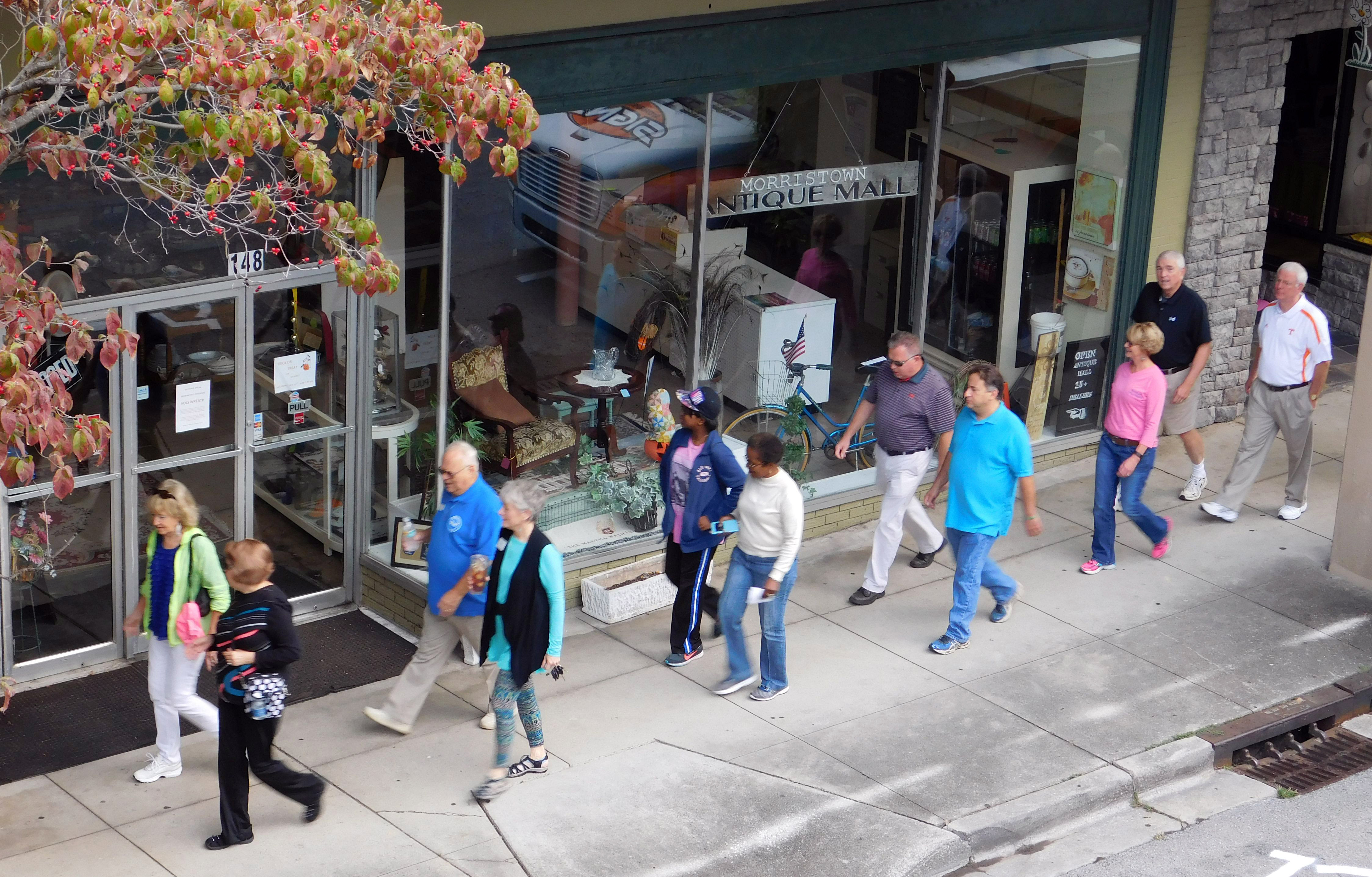 Participants in the Mayors' Mile walk for brain health make their way through downtown Morristown.