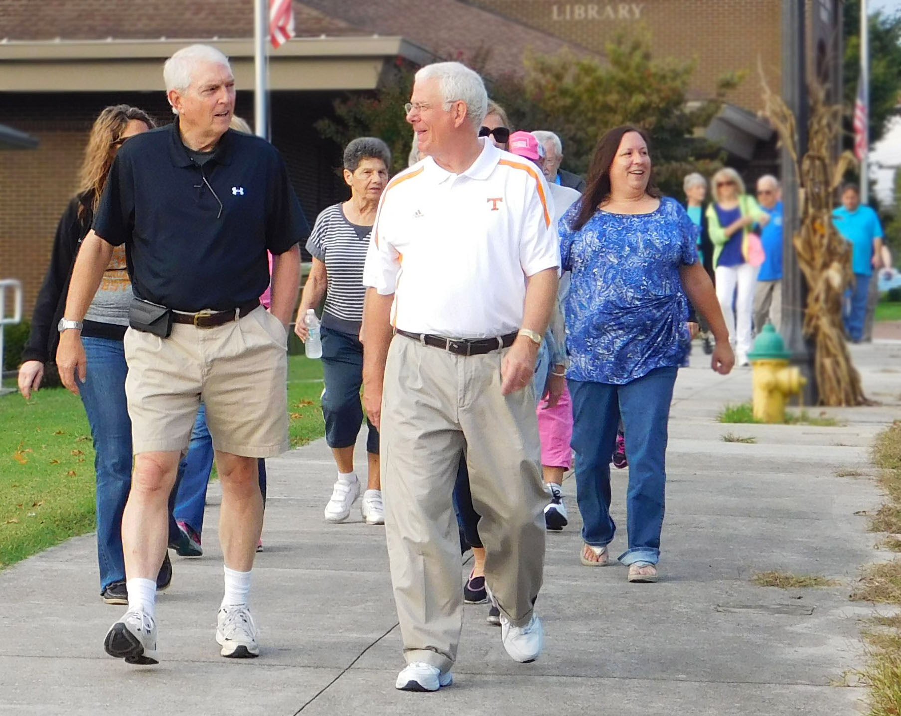 Mayors Gary Chesney and Bill Brittain lead the Mayors' Mile walk for brain health.