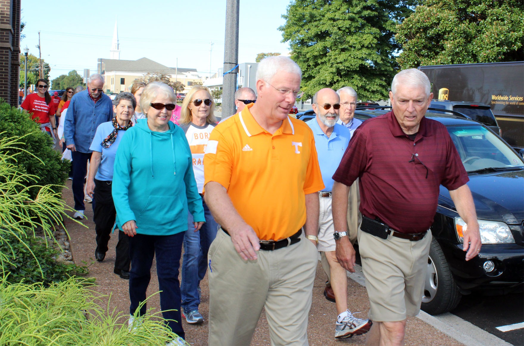 Mayors Bill Brittain and Gary Chesney lead the Mayors' Mile walk for brain health.