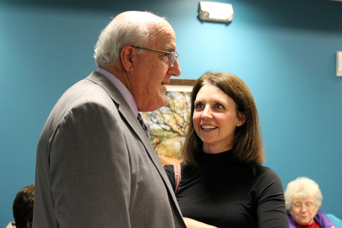 TCAD Aging Commission Liaison (and Brain Games MC) Anna Lea Cothron talks to Jonesborough Town Administrator Bob Browning.