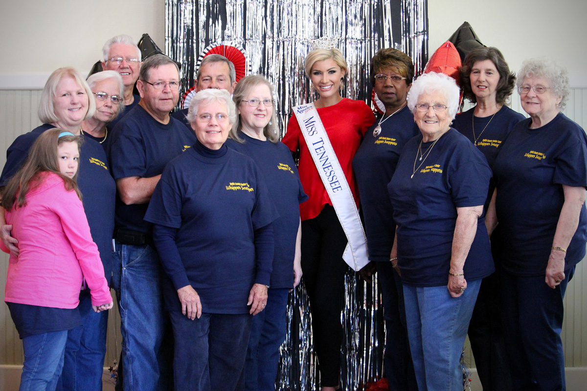The Smith County Whipper Snappers pose with Miss Tennessee.