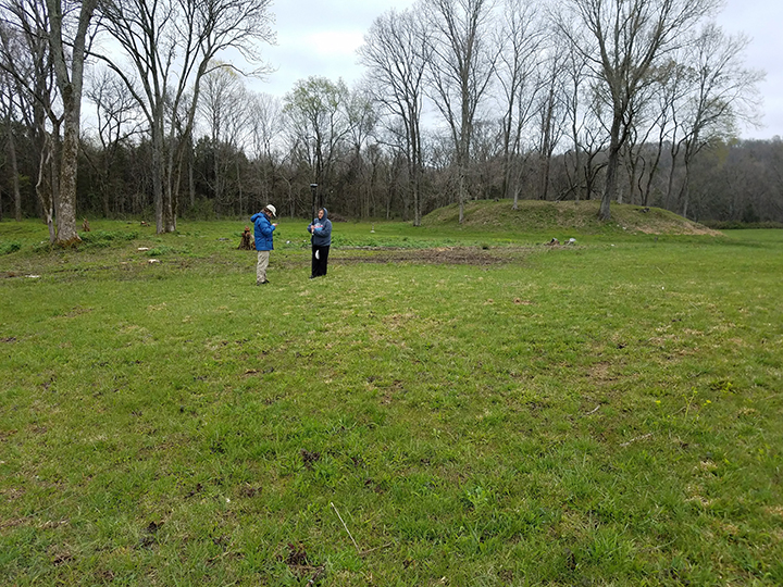 View of the main platform mound (right) and palisade portion (left) Vanderbilt University students are seen taking a GPS at the site.