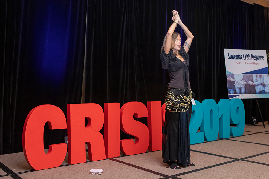 Dina Savvenas teaches a bellydancing session at the 2019 Crisis Services conference. Photo credit: Roland's Photography