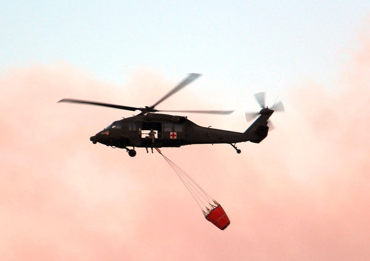 "Blackhawk with 800 gallon ""Bambi"" bucket used to drop water on fires."