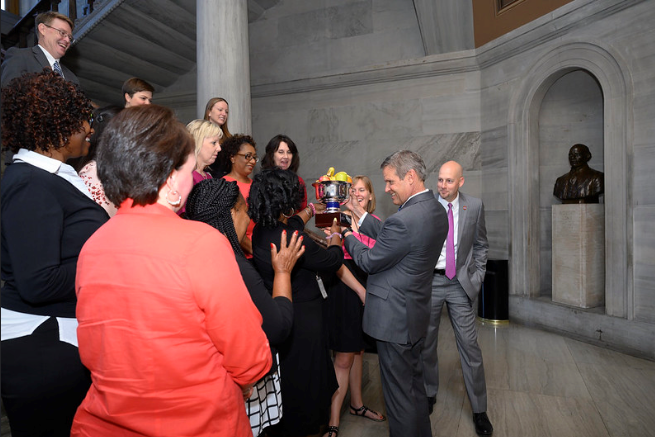 Governor Lee asked if he could have some fruit from the trophy for a healthy snack! Of course, they said yes.