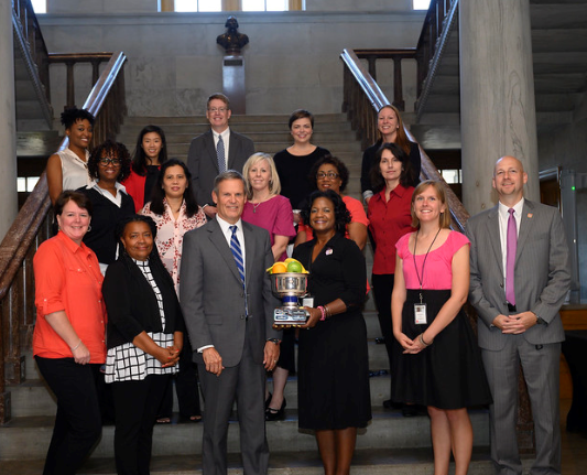 In October, the champs were honored for their incredible workplace wellness efforts by Governor Bill Lee during a group photo at the Capitol. (The Working for a Healthier TN team is also pictured.)
