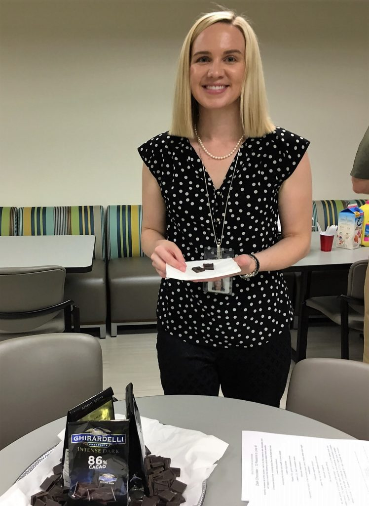 The Department of Children's Services hosted a healthy taste test for employees. The group learned about the benefits of eating a breakfast with whole grains by enjoying a healthy cereal, and they also tried a sample of dark chocolate made of 86% cacoa.