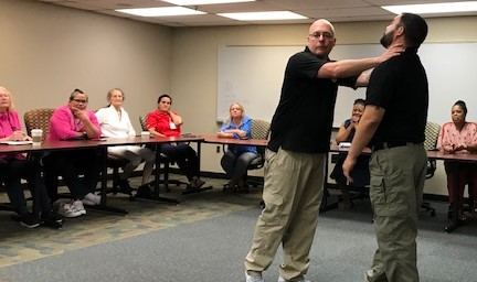 Employees at the Department of Correction attended a self defense class.