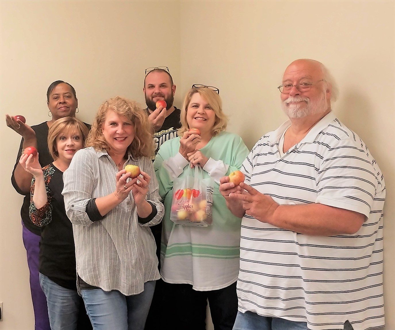 Employees at the Elizabethton office of the Department of Human Services observed Apple Month. Each staff member was given an apple from a local orchard and a healthy/baked apple recipe. They also tried office exercises during a meeting.