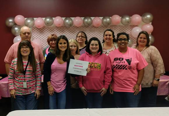 Employees from the Department of Human Services in Roane County helped raise awareness about the early detection of breast cancer by wearing pink.