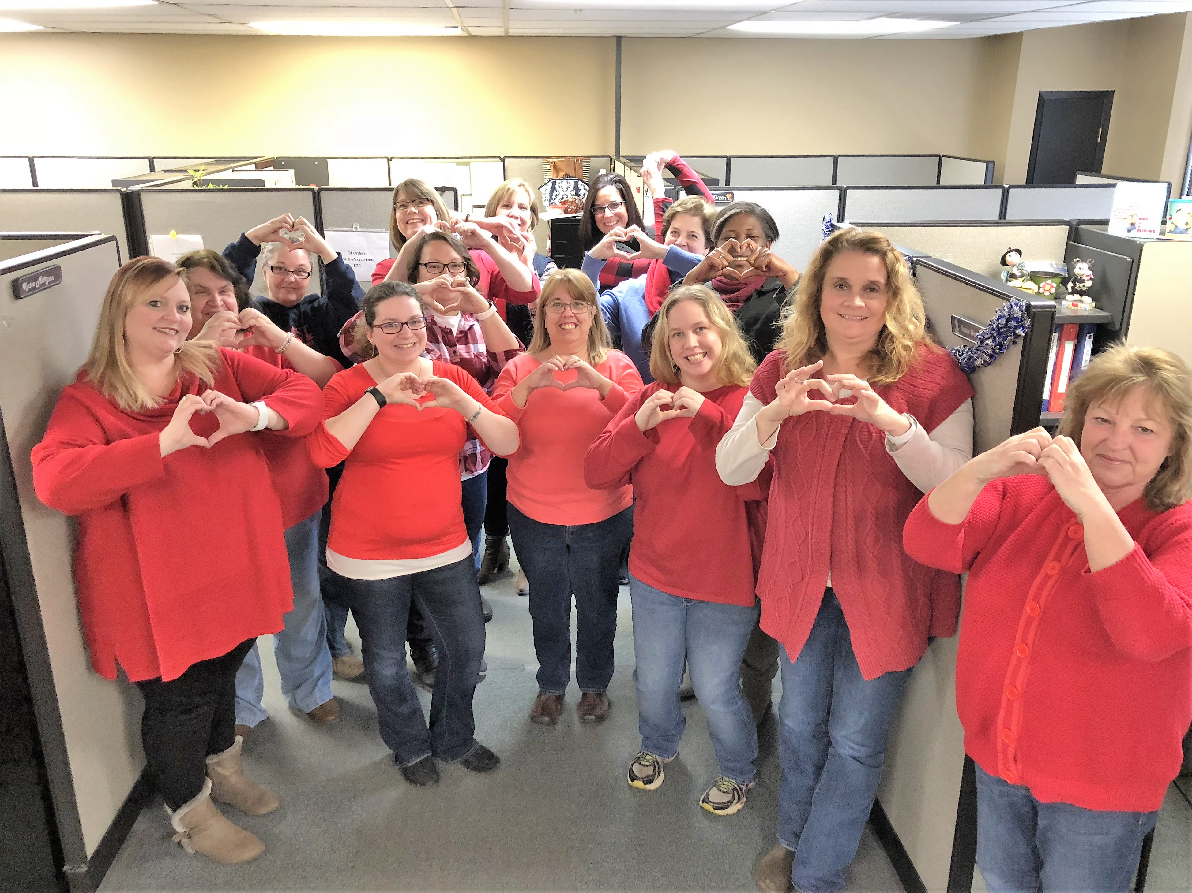 Employees at the Dandridge office wear red to raise awareness for heart disease prevention.