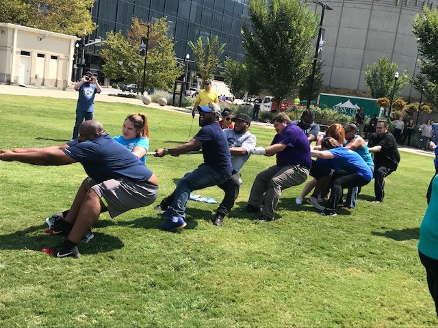 Employees from DHS competed in a tug of war competition. They were kind enough to let three F&A employees join their team.