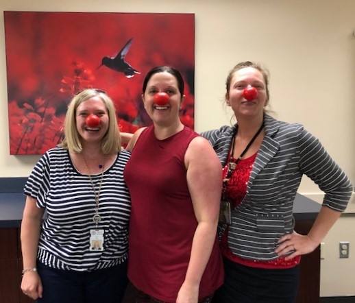 Employees took a wellness walk to celebrate Red Nose Day and raise awareness about child poverty.