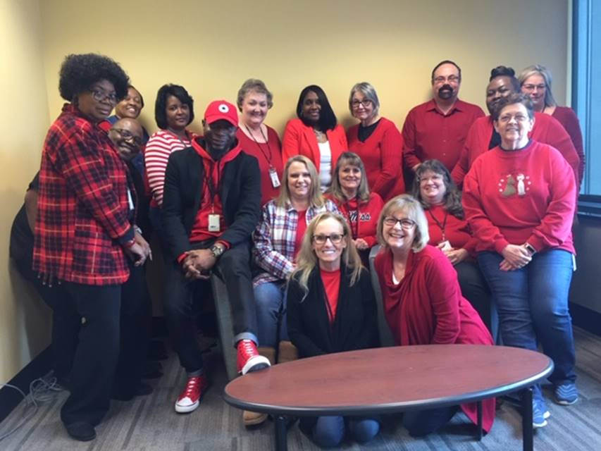 Employees in the West Regional Office wearing red to raise awareness about heart disease prevention.