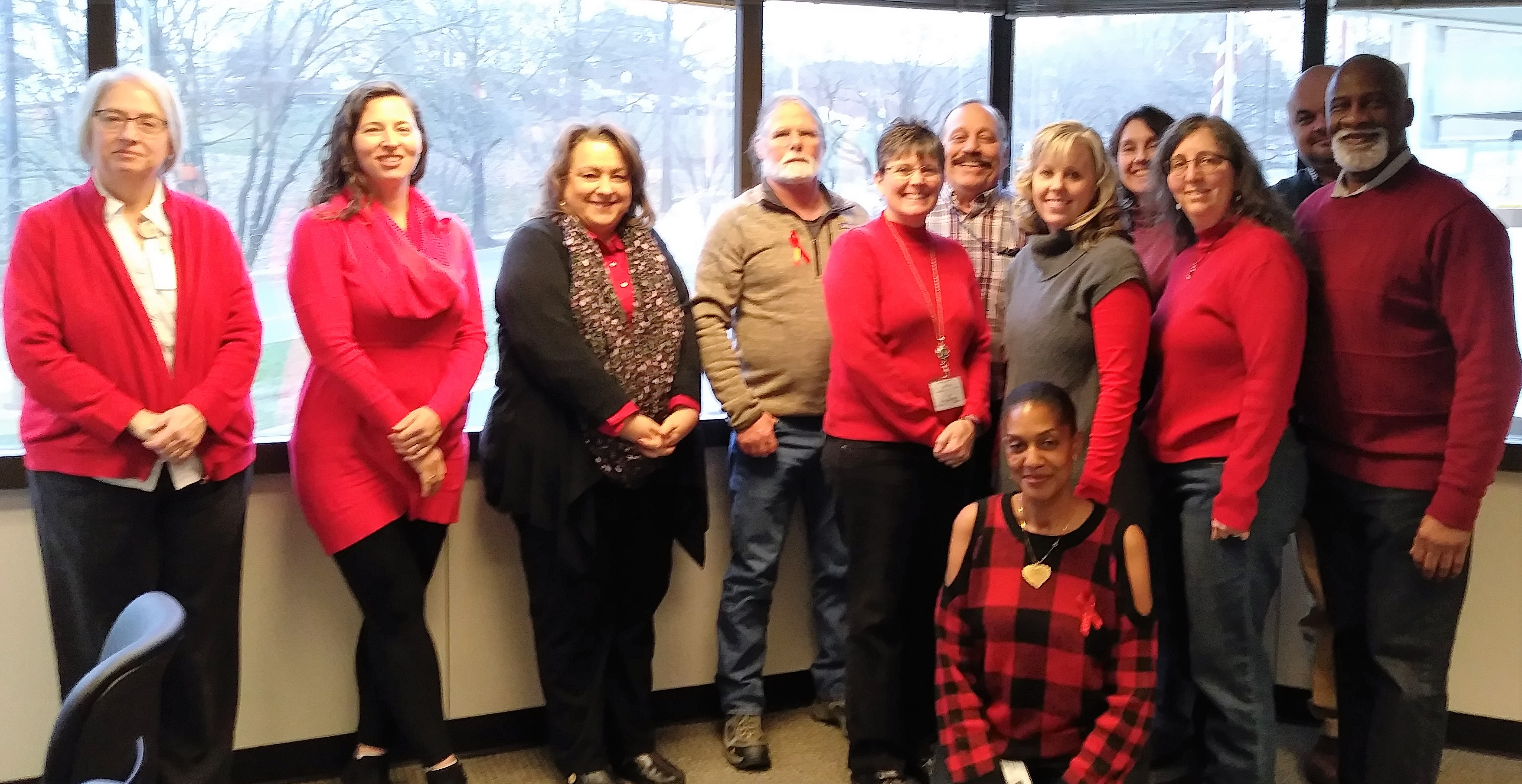 Employees in Knoxville wearing red to raise awareness about heart disease prevention.