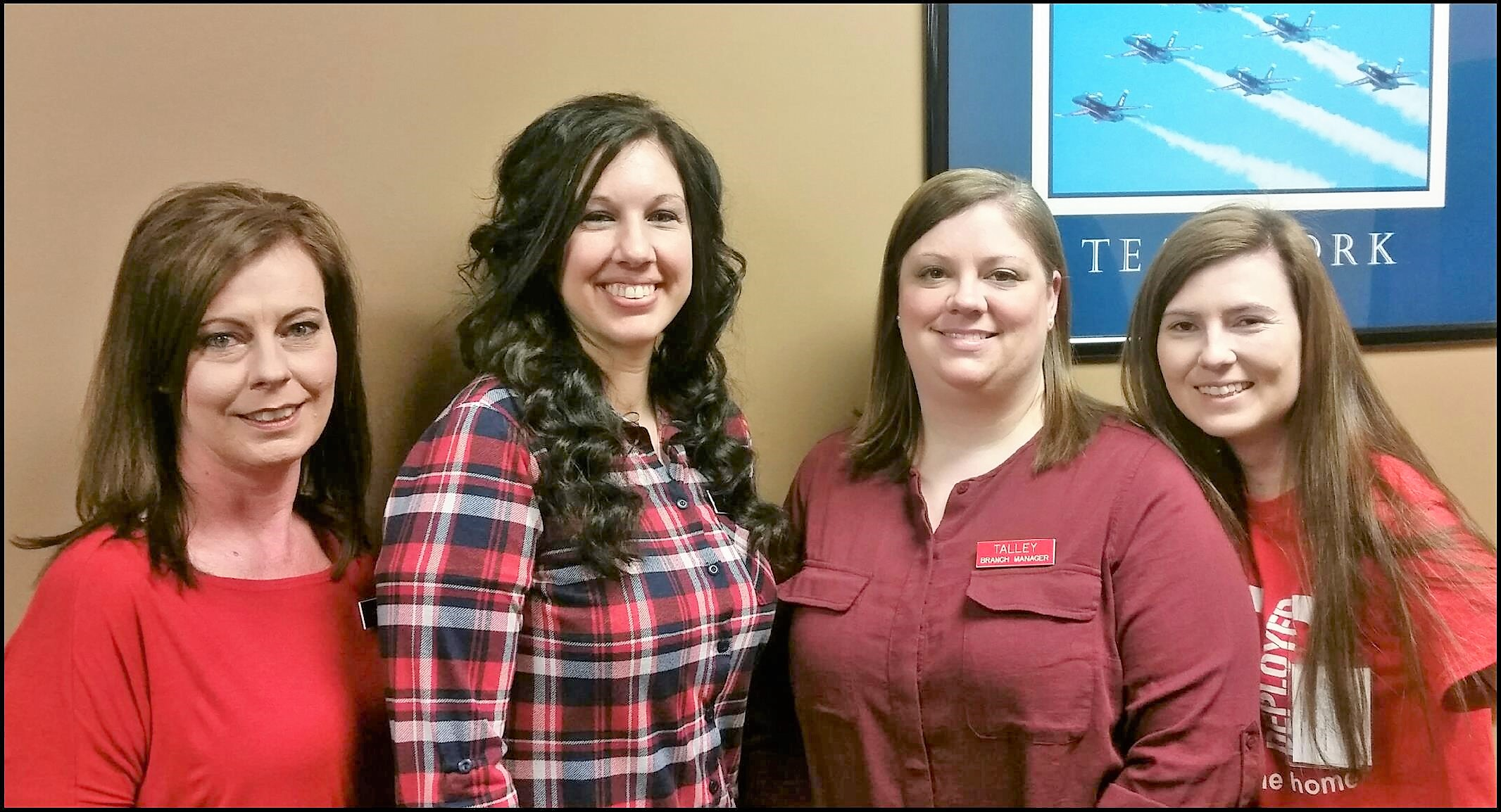 Employees wear red to raise awareness about heart disease prevention.