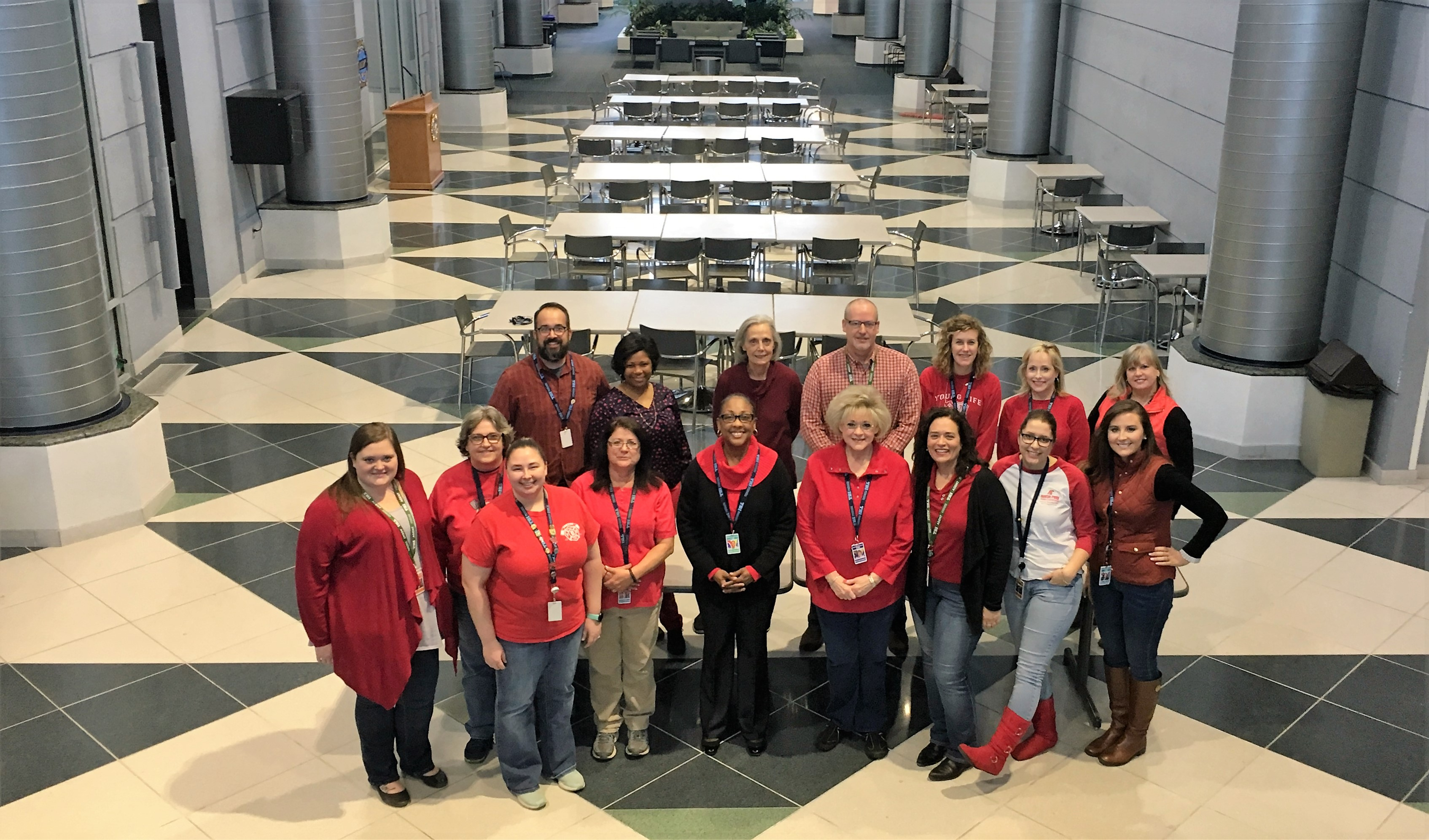 TBI employees wearing red to help raise awareness for heart disease prevention.
