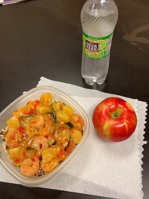 "Kim Mullen had this ""healthy and yummy"" lunch to help get her five servings of fruits and veggies: sweet and sour shrimp with zucchini, red bell pepper, onion and pineapple with an apple."