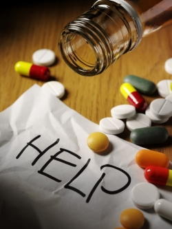 Pills_spilled_help_sign