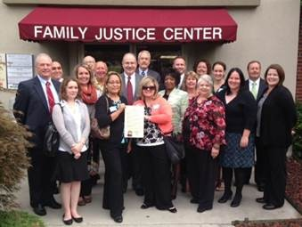 Leaders from the Upper Cumberland Family Justice Center team pose for a picture with their proclamation signed by Governor Haslam