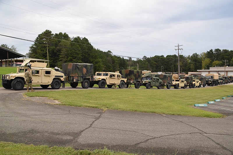 Members of the Tenn. Guard's 117th Military Police Battalion prepare to depart battalion headquarters in Athens, Tenn. for South Carolina, September 16, 2018.