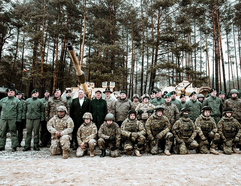 U.S. Secretary of State Michael R. Pompeo poses with Allied troops from NATO's Enhanced Forward Presence Forces, which include soldiers of the 278th Armored Cavalry Regiment, at the Bemowo Piskie Training Area in Poland on February 13, 2019.