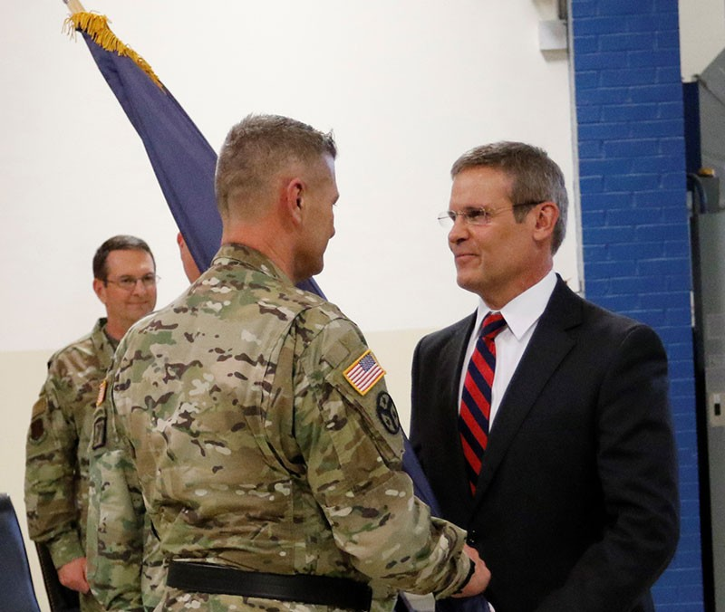 Maj. Gen. Jeff Holmes, Tennessee's 76th Adjutant General, receives the Military Department flag from Tennessee Governor Bill Lee during a change of command ceremony at the Joint Force Headquarters in Nashville on March 3, 2019. (U.S. Army photograph courtesy of Staff Sgt. Mathieu Perry)