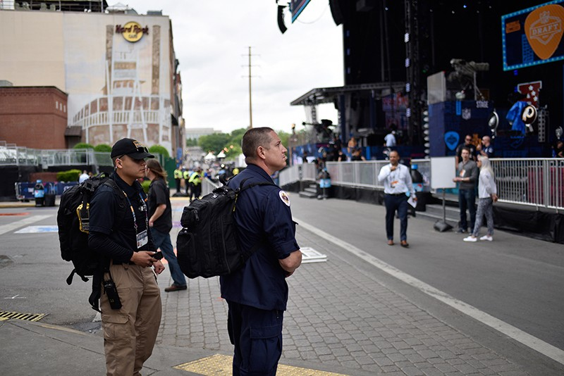 A 45th CST member and Nashville Firefighter near the NFL Draft stage in Nashville