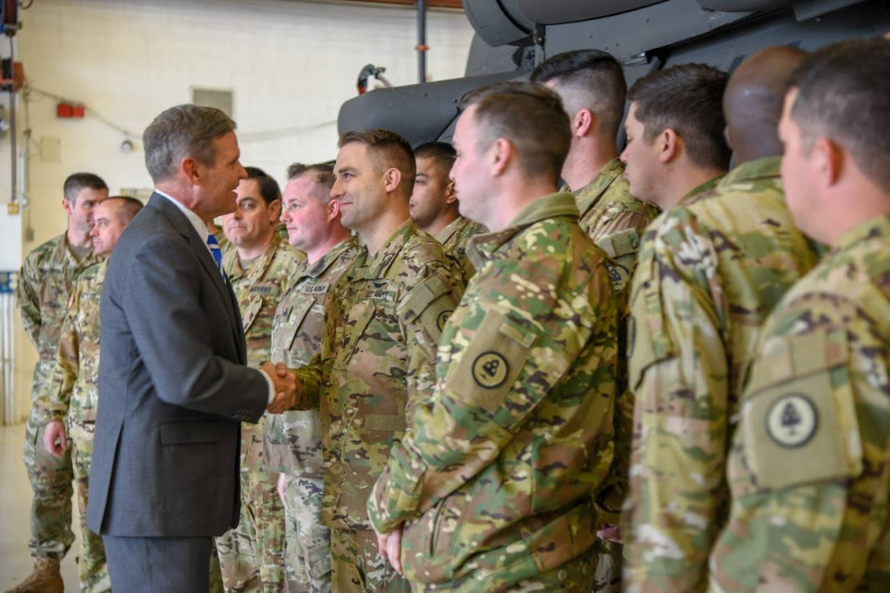 Tennessee Governor Bill Lee shakes hands with a member of the Tenn. Army National Guard's 2-135th Aviation Regiment