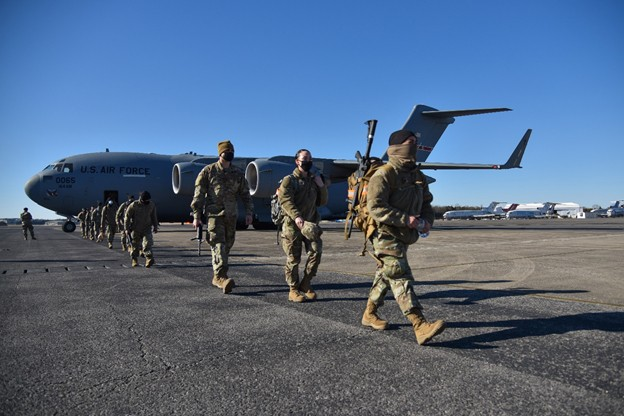 Tennessee National Guard Soldiers on runway with plane in background