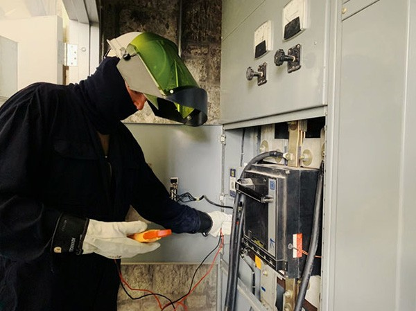 Staff Sgt. Robert Moore, working in electrical protective gear, tests electric power provided by generators from the 118th Civil Engineer Squadron as it powers the Army National Guard Armory in Chattanooga. (Photo by Lt. Col. Marty Malone)