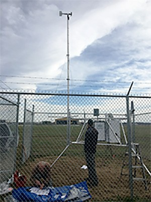 Remote Automatic Weather Station in Tipton County being serviced