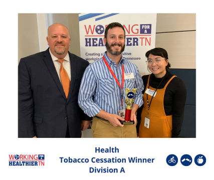 Health's Wellness Council accepts award for Tobacco Cessation.