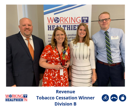 Revenue accepts trophy for Tobacco Cessation.